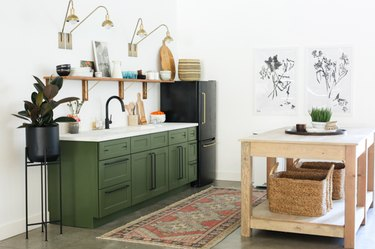 white and olive green kitchen color idea with wood island and white countertop