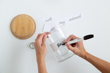 Add hand-lettered labels to IKEA 365+ glass jars.