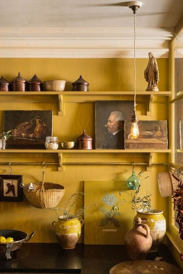 Turmeric yellow kitchen color idea with yellow shelving