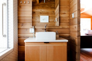 bathroom space with wood cabinets and backsplash