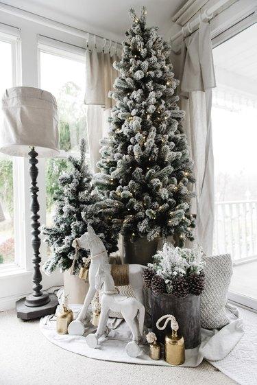 Farmhouse Christmas tree idea with two trees in corner near windows