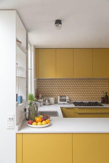 Yellow kitchen color idea with yellow backsplash tile