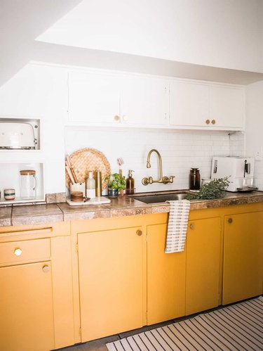 yellow kitchen color idea with white upper cabinets