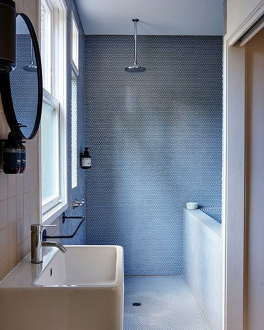 simple minimal small bathroom space with open shower