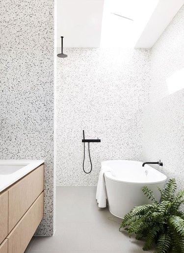 Monochrome terrazzo bathroom and open shower