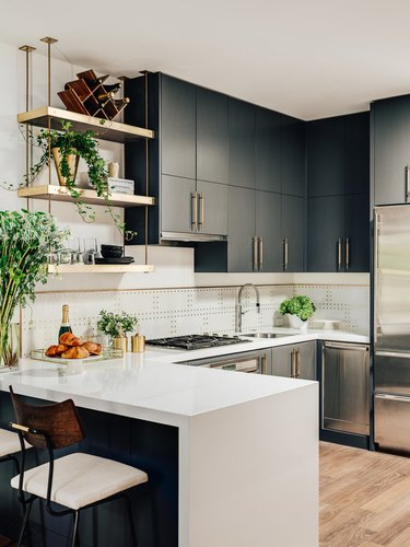 modern kitchen with mixed metal finishes and single-bowl sink