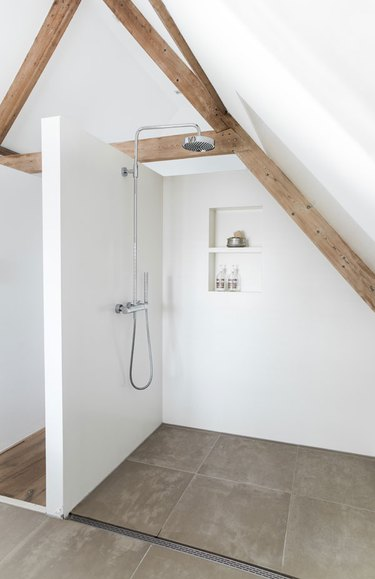 open shower in difficult space with partition wall