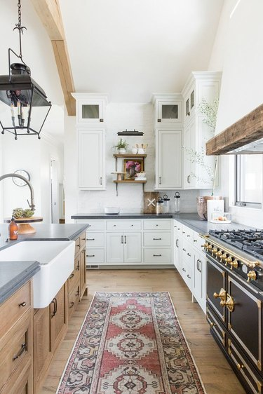 farmhouse kitchen with exposed beams and single bowl apron sink