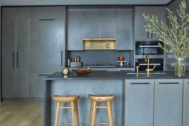 Blue Chelsea Kitchen with waterfall countertop by Jarret Yoshida