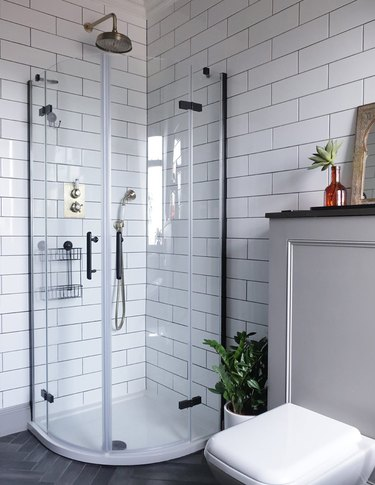 small shower idea in the corder with glass enclosure and black fixtures