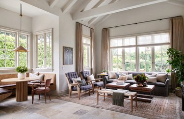 farmhouse flooring idea in living room with tumbled limestone floor