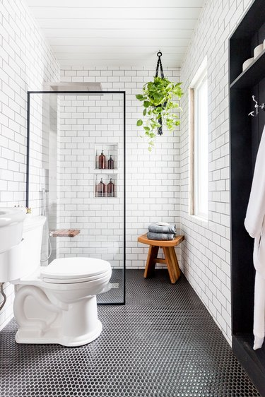 modern small shower idea with white subway tile and black shower screen