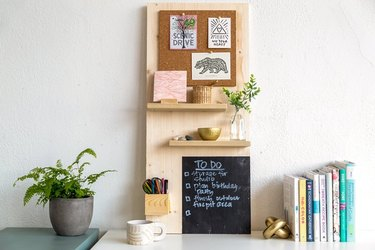 Wood organization board with chalk board and shelves on desk.