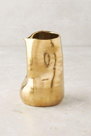 gold mishapen vase