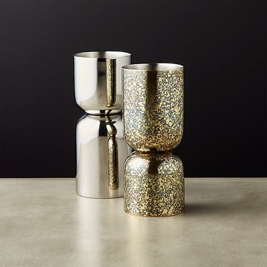 silver and gold jiggers