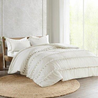 boho bedding with pom poms