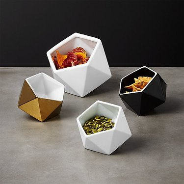white, black, and hold geometric bowls