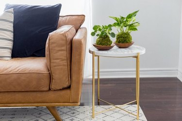 IKEA Gladom table with gold and marble accents.