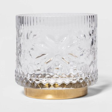 clear and gold candle holder