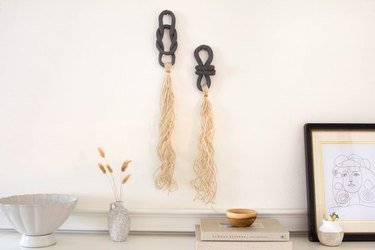 Clay and tassel wall hanging.