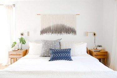 white bohemian bedroom with ombre wall decor
