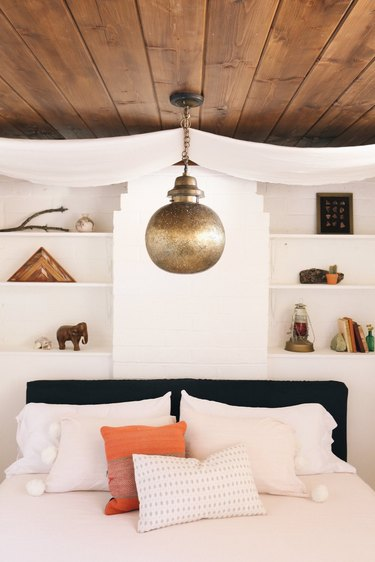 white bohemian bedroom with global decor