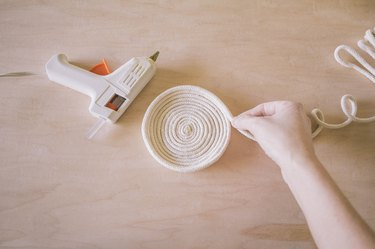 Stacking and gluing rows of rope on top of each other to create bowl