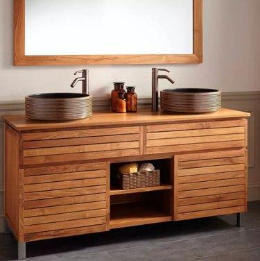 teak bathroom vanity with large mirror