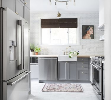 gray kitchen cabinets and white subway tile