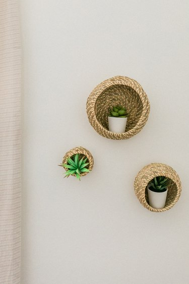 We love the boho-inspired natural texture of these plant basket shelves.