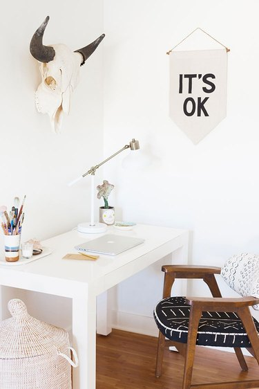 Boho office with banner and white desk