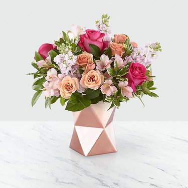 pink flowers in geometric vase