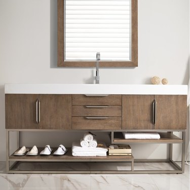 wood bathroom vanity with rectangular mirror above
