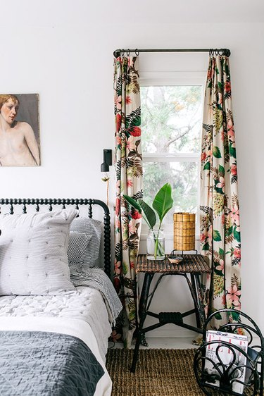 bedroom curtain idea with floral window treatment in contemporary master bedroom