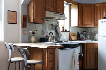 Small kitchen with wood cabinets