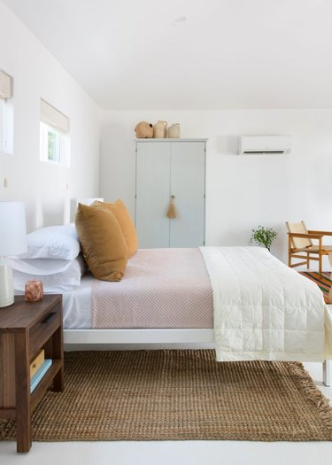 guest bedroom  idea with tall storage cabinet