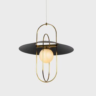 Art deco lighting with circular, modern details and exposed LED light bulb