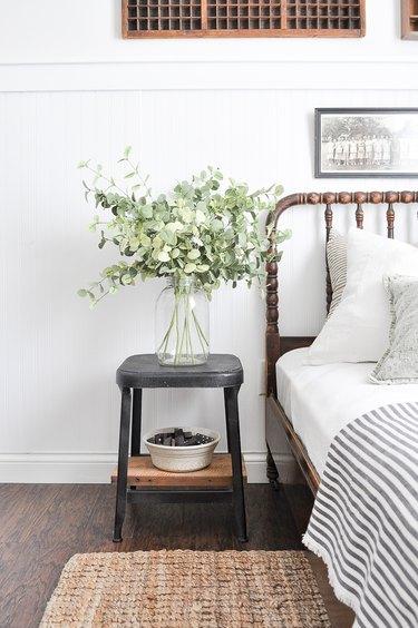 white farmhouse guest bedroom  idea with vase full of eucalyptus