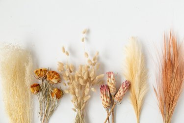 Dried grass and flowers for wedding centerpiece