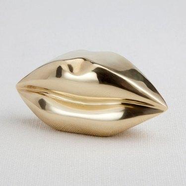 brass lips Hollywood Regency accessory from Kelly Wearstler