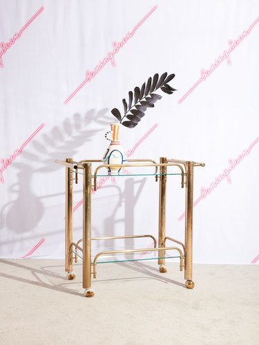 brass bar cart with vase and flower Hollywood Regency accessory from Coming Soon New York