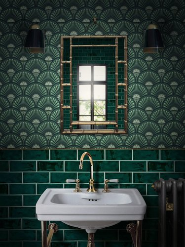 art deco bathroom by Divine Savages with patterned wallpaper and subway tile
