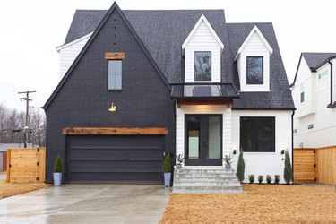 craftsman style house painted in black and white