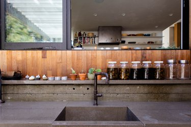 close up of concrete kitchen countertop and sink