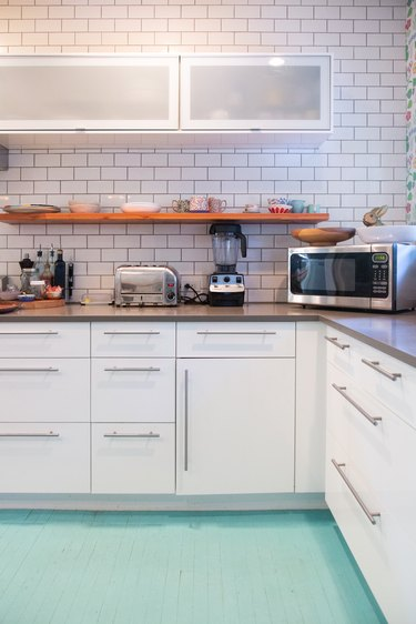white kitchen with Tiffany blue floor