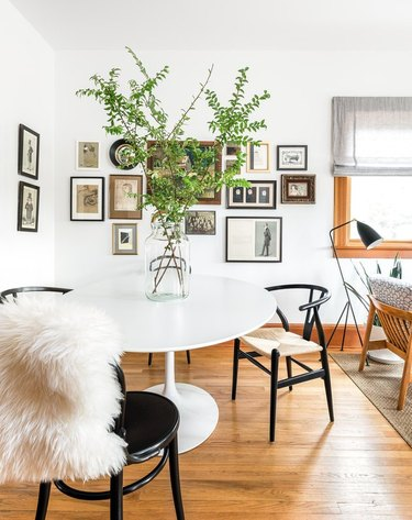 Dining room table and chairs with sheepskin