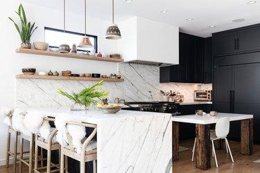 kitchen with natural stone backsplash and matching island