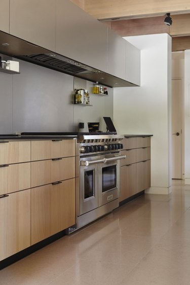 minimalist kitchen with black countertops