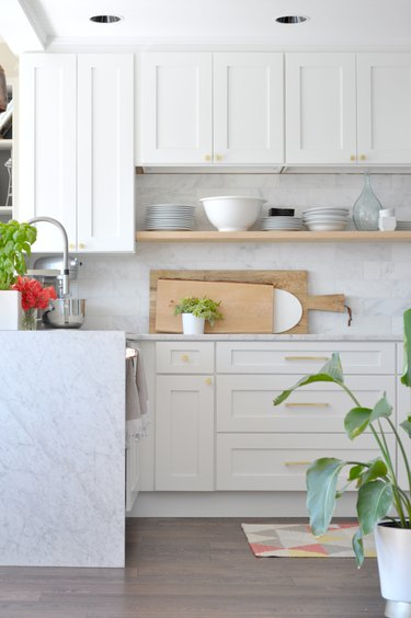 Exposed wood shelving and marble white countertops