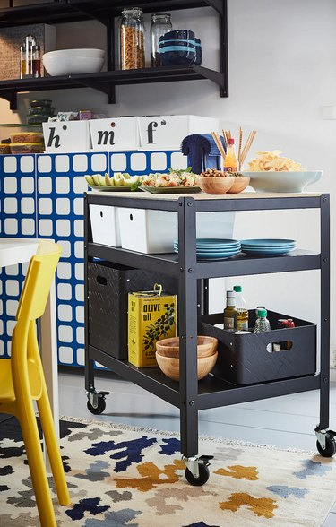 Industrial IKEA kitchen island in black with wheels in contemporary kitchen